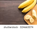 banana on the wooden background.... | Shutterstock . vector #324663374