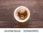 glass of beer on a wooden... | Shutterstock . vector #324663401