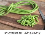 Cut Of Long Bean On Wood...