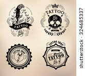 set vector tattoo studio logo... | Shutterstock .eps vector #324685337