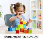 child little girl playing... | Shutterstock . vector #324698291