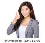 asian young businesswoman... | Shutterstock . vector #324711701