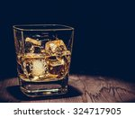 glass of whiskey with ice cubes ... | Shutterstock . vector #324717905