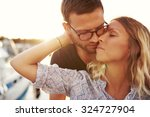 couple kissing on a summer... | Shutterstock . vector #324727904