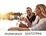 happy couple toasting glasses... | Shutterstock . vector #324727994