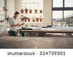 young male business owner... | Shutterstock . vector #324739301