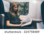 woman is reading the book on... | Shutterstock . vector #324758489