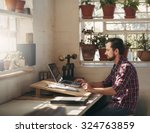 young designer typing on his... | Shutterstock . vector #324763859