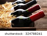 box with straw and wine bottles ... | Shutterstock . vector #324788261