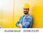 worker with helmet and yellow... | Shutterstock . vector #324815135