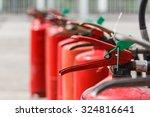 red fire extinguishers... | Shutterstock . vector #324816641