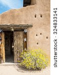 Small photo of Whimsical entry to a southwestern adobe building