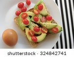 avocado and rosa tomatoes on... | Shutterstock . vector #324842741