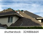 home with roof being replaced... | Shutterstock . vector #324886664