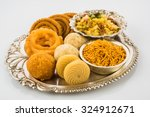 diwali food   snacks   sweets... | Shutterstock . vector #324912671