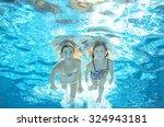 Children Swim In Pool Or Sea...