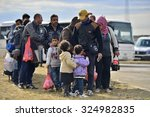 refugees entering refugee camp... | Shutterstock . vector #324982835