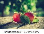 apples on wooden table over... | Shutterstock . vector #324984197
