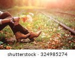 Woman Sitting On Rail Trails...