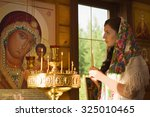 Russian Woman With Candles In...