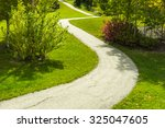 Winding Park Path Framed With...