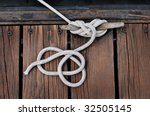 White Rope Securing Boat To...