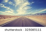 vintage style country highway... | Shutterstock . vector #325085111