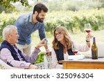 portrait of family winemakers... | Shutterstock . vector #325096304