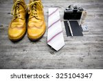 neourban hipster fashion travel with items handemade leather shoes, analog camera, notebook, pen, lighter, tie