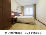 hotel bedroom interior | Shutterstock . vector #325145819