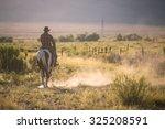 Cowboys Riding A Horse Over Th...