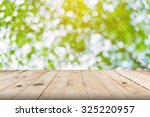 green leaf bokeh blurred and...   Shutterstock . vector #325220957