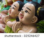 thai baked clay doll with... | Shutterstock . vector #325246427