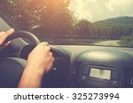 driving and holding the... | Shutterstock . vector #325273994