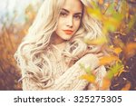 outdoor fashion photo of young... | Shutterstock . vector #325275305