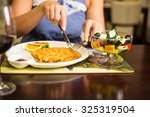 potato cutlets with sour cream | Shutterstock . vector #325319504