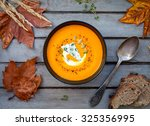 hot pumpkin soup with blue... | Shutterstock . vector #325356995