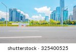 empty asphalt road in modern... | Shutterstock . vector #325400525
