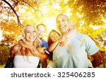 family playing outdoors... | Shutterstock . vector #325406285