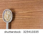 wooden spoon with bean | Shutterstock . vector #325413335