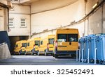 Yellow Delivery Vans In A Row...