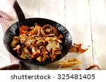 Small photo of Delicious assortment of fried autumn mushrooms including king oyster or pleurotus mushrooms, ready to serve as a healthy vegetarian snack or accompaniment to a meal
