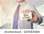 businessman in office showing... | Shutterstock . vector #325483484