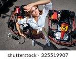 girl  with helmet in carting | Shutterstock . vector #325519907