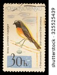 Small photo of CZECHOSLOVAKIA - CIRCA 1964: A postage stamp printed in Czechoslovakia shows a common redstart, Phoenicurus phoenicurus, an european flycatcher with affinity with the robin, circa 1964