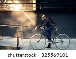 a young stylish businessman... | Shutterstock . vector #325569101