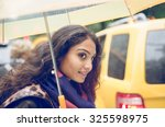 indian girl in new york in a... | Shutterstock . vector #325598975