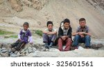 Small photo of Leh, India - Jul 22, 2015. Group of Tibetan chidren sitting together on the road to Nubra Valley, India. 65% of children attend school, but absenteeism of both students and teachers remains high.