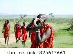 Masai Kudu Horn Blowing   Kenya