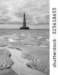 Small photo of Black and white view of the historical lighthouse of Cordouan at low tide, Gironde estuary, France